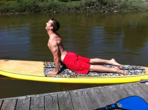 Jeff Gehring Upward dog on a SUP